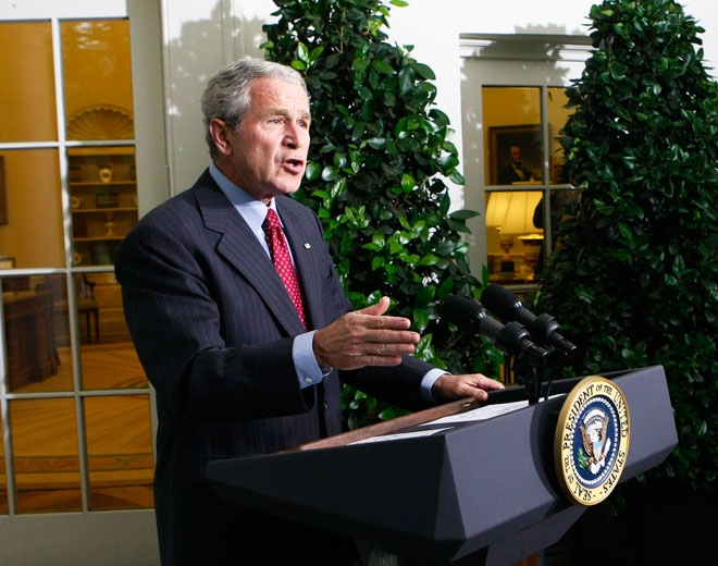 U.S. President Bush delivers remarks to members of the media outside the Oval Office of the White House in Washington on Friday, Sept. 26, 2008. (AP / Pablo Martinez Monsivais)