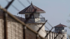 The government will close Kingston Penitentiary, the country's oldest penal institution, as part of a cost-cutting effort. (Lars Hagberg / THE CANADIAN PRESS)