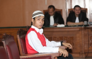 Child sexual abuse suspect Virgiawan Amin sits on the defendant's chair during his trial at South Jakarta District Court in Jakarta, Indonesia, Monday, Dec. 22, 2014. (AP Photo/Tatan Syuflana)