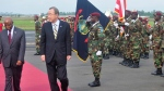 UN Secretary General Ban Ki-moon, centre, inspects the honor guard upon arrival at the Roberts international airport in Monrovia, Liberia, Friday, Dec. 19, 2014.  (AP /Abbas Dulleh)