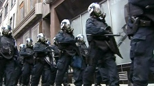 Police march the street in unison in Montreal, Friday, April 20, 2012.