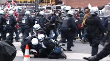 Police and protesters clash in Montreal, Friday, April 20, 2012.