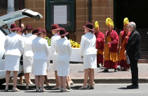 White Lady funeral directors move the coffin of Tori Johnson into a hearse during a funeral service in Sydney, Australia, Tuesday, Dec. 23, 2014. (AP / Rob Griffith)