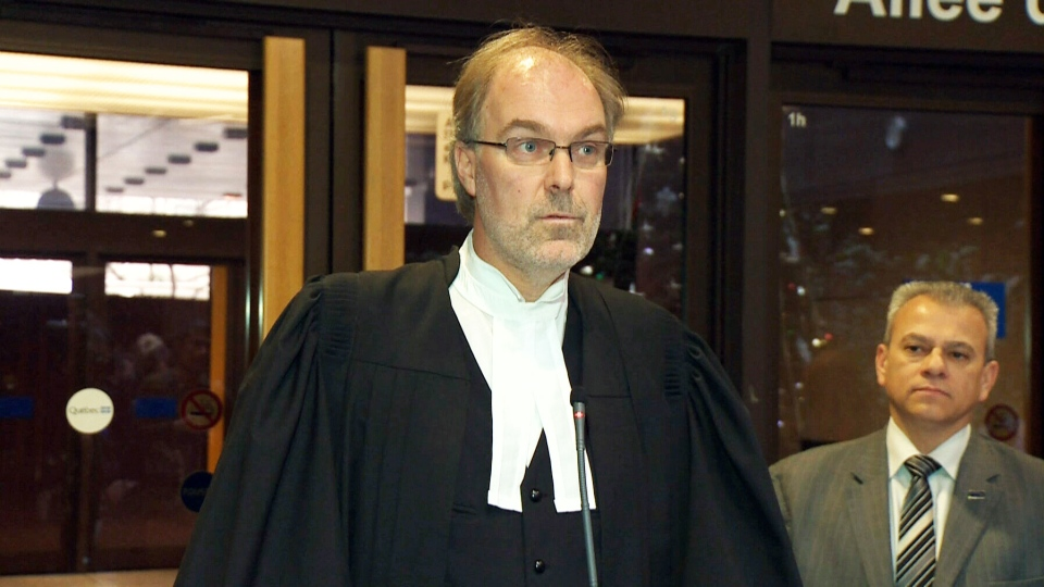 Crown prosecutor Louis Bouthillier speaks to reporters outside a courthouse following the verdict in the Luka Rocco Magnotta case in Montreal on Tuesday, Dec. 23, 2014.