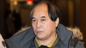 Diran Lin, father of Jun Lin leaves the Montreal Courthouse following the murder trial for Luka Rocco Magnotta, Tuesday, Dec. 23, 2014. (Graham Hughes / THE CANADIAN PRESS)