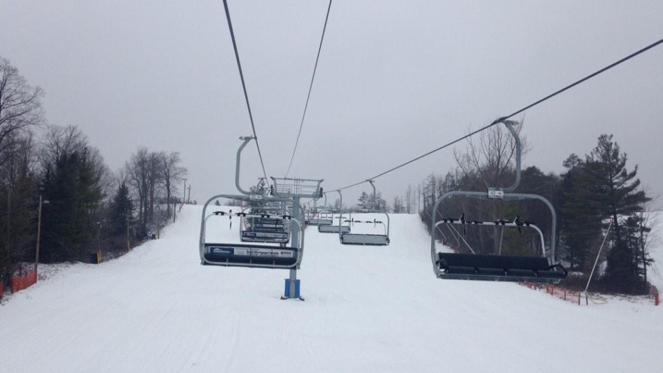 A chairlift is seen at Chicopee Ski Hill in Kitchener, Ont., on Tuesday, Dec. 23, 2014. While the hill looks snowy, rain and wind are expected to melt most of the snow before Christmas. (Krista Simpson / CTV Kitchener)