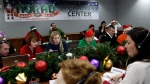 Volunteers take phone calls from children asking where Santa is and when he will deliver presents to their house, during the annual NORAD Tracks Santa Operation, at the North American Aerospace Defense Command, or NORAD, at Peterson Air Force Base, Colo. Dec. 24, 2012. (AP / Brennan Linsley, File)