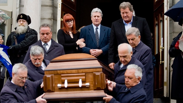 Family members of Emile Bouchard look on as his coffin is removed following his funeral in Longueuil, Que., Saturday, April 21, 2012. (Graham Hughes /THE CANADIAN PRESS)