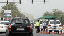 Police officers man a checkpoint outside the Formula One Bahrain International Circuit in Sakhir, Bahrain, Sunday, April 22, 2012. Security remained tight amid expectations of fresh anti-government protests on race day of the Formula One Bahrain Grand Prix. (AP Photo/Hassan Ammar)