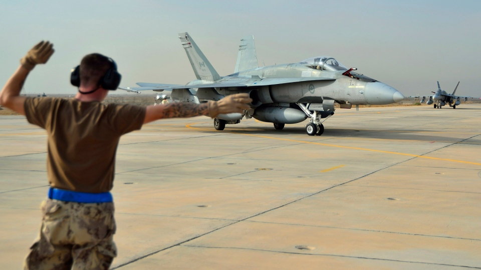 A Canadian Armed Forces CF-18 Fighter jet from 409 Squadron taxis after landing in Kuwait on Tuesday October 28, 2014. (HO, DND-MND / THE CANADIAN PRESS)