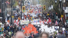 Thousands of people march in Montreal, Sunday, April, 22, 2012, to mark international Earth Day. THE CANADIAN PRESS/Graham Hughes