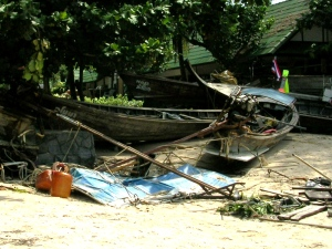 A photo taken by the Lightman family in the immediate aftermath of the 2004 Indian Ocean tsunami shows longboats washed up on the beach in southern Thailand.