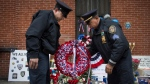 Members of the New Rochelle, N.Y. police department place a wreath at a makeshift memorial near the site where NYPD officers Rafael Ramos and Wenjian Liu were murdered in the Brooklyn borough of New York, Monday, Dec. 22, 2014. (AP / John Minchillo, File)