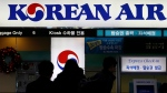 Passengers wait to check in at the domestic check-in desk of Korean Air Lines Co. at Gimpo Airport in Seoul, South Korea, Tuesday, Dec. 16, 2014. (AP / Lee Jin-man)
