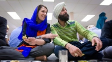 Wildrose leader Danielle Smith, left, shares a meal while making a campaign stop at a Sikh temple in Calgary, Alta., Sunday, April 22, 2012. (Jeff McIntosh / THE CANADIAN PRESS)