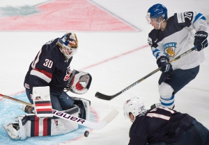 USA's goaltender Thatcher Demko (30) makes a save against Finland's Juuso Ikonen (10) as USA's Alex Tuch (17) defends during the first period of preliminary round hockey action in the IIHF World Junior Championship in Montreal, Friday, December 26, 2014. (THE CANADIAN PRESS/Graham Hughes)