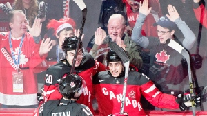 Canada's Robby Fabbri, right, celebrates with teammates Nick Paul, left, and Nic Petan after scoring against Slovakia during first period preliminary round hockey action at the IIHF World Junior Championship in Montreal, Friday, December 26, 2014. (Graham Hughes / THE CANADIAN PRESS)