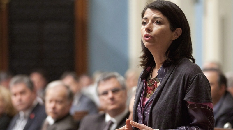 In this April 19, 2012 file photo, Quebec Education Minister Line Beauchamp responds to Opposition questions over tuition hikes at the legislature in Quebec City. THE CANADIAN PRESS/Jacques Boissinot