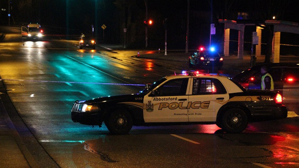 Police cordon off part of an intersection near a local mall in Abbotsford, B.C., Friday, Dec. 26, 2014, after a 14-year-old pedestrian was struck by an off-duty police officer. He later died in hospital. (CTV)