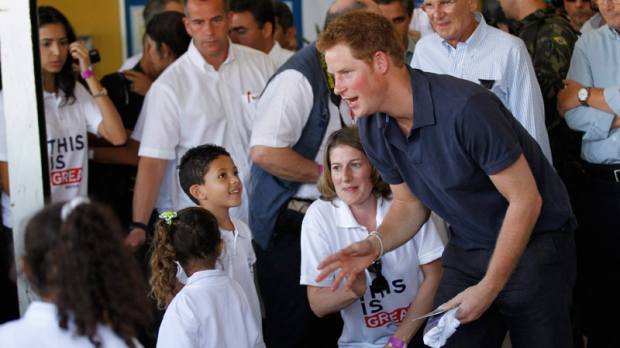 Prince Harry talks with children during his visit to the Complexo do Alemao slum,in Rio de Janeiro, Brazil, Saturday, March 10, 2012. (AP  / Silvia Izquierdo)
