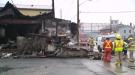 Firefighters battle a fire in Plattsville, Ont. on Saturday, Dec. 27, 2014.