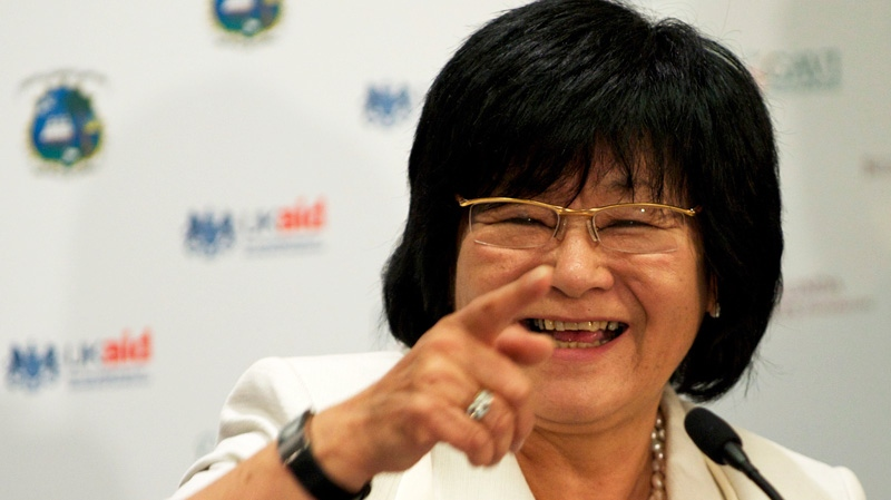 International Development Minister Bev Oda points at a donors conference in London during the 2011 GAVI Alliance. (Ben Fisher /  THE CANADIAN PRESS)