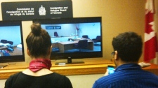 Reporters wait during a delay in Belhassen Trebalsi's Immigration and Refugee Board hearing in Montreal on Monday April 23, 2012. (CTV News / Stephane Giroux)