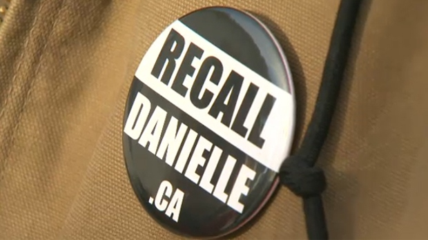 A doorknocker with the Recall Danielle movement wears a campaign button