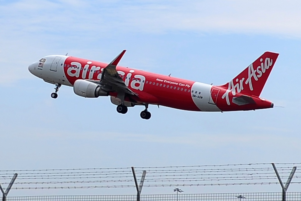 In this May 9, 2014 photo, an AirAsia A320-200 plane takes off from Kuala Lumpur International Airport 2 in Sepang, Malaysia. The plane in this photo is the same model but not the one which went missing in Indonesia. (AP / Joshua Paul)