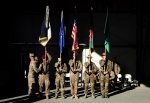 In this Dec. 8, 2014 file photo, International Security Assistance Forces honour guards take part in a flag-lowering ceremony in Kabul, Afghanistan.  (AP / Massoud Hossaini)