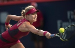 Eugenie Bouchard returns a serve during second round play at the Rogers Cup tennis tournament in Montreal in this Tuesday, Aug. 5, 2014 file photo. (THE CANADIAN PRESS / Paul Chiasson)