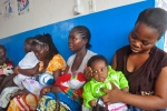 Mothers wait in line for their children to be vaccinated by heath workers at the Pipeline Community Health Center, situated on the outskirts of Monrovia, Liberia in this Monday, Nov. 3, 2014 file photo. (AP / Abbas Dulleh)