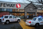 Transit Police and RCMP vehicles are seen in front of a Safeway store in Surrey after a man was fatally shot Sunday, Dec. 28, 2014. (CTV)