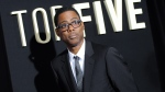 """Actor Chris Rock attends the premiere of """"Top Five"""" at the Ziegfeld Theatre in New York,Dec. 3, 2014. (Photo by Evan Agostini / Invision)"""