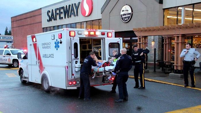 A man is loaded into a stretcher after being shot by Transit Police at a Safeway in Surrey, B.C., Sunday, Dec. 28, 2014. The man later died in hospital. (CTV)