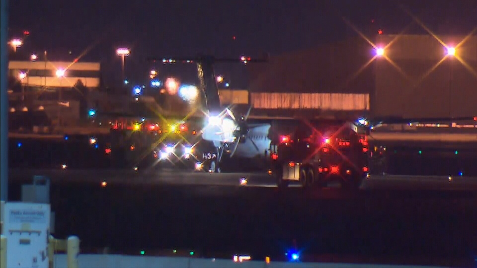 Porter Airlines flight PD539 safely on the ground after an emergency landing at Pearson Airport in Toronto, on Dec. 28, 2014.