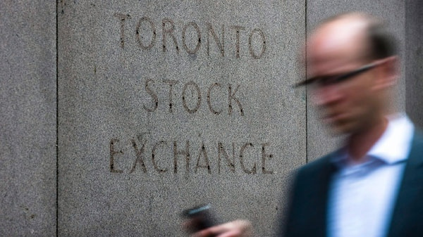 A man walks past a building in Toronto that used to house the Toronto Stock Exchange on Thursday, August 18 2011. (Aaron Vincent Elkaim / THE CANADIAN PRESS)