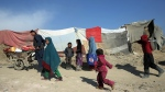 In this file photo, Afghans leave as they receive winter aid distributed by Muslim Hands, a U.K.-registered international aid organization, in Kabul, Afghanistan, Sunday, Jan. 5, 2014. (AP/Massoud Hossaini)