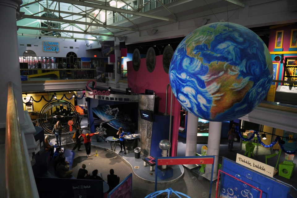 A model earth hangs in the air during an adult science night at the Saskatchewan Science Centre in Regina on Thursday, December 18, 2014. (Michael Bell / THE CANADIAN PRESS)