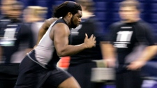 Illinois offensive lineman Xavier Fulton runs a drill at the NFL Scouting Combine in Indianapolis, Saturday, Feb. 21, 2009. (AP Photo/Darron Cummings)