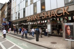 The exterior of a Shake Shack location in New York's theatre district is shown in this May 21, 2014 file photo. (AP / Mark Kennedy)