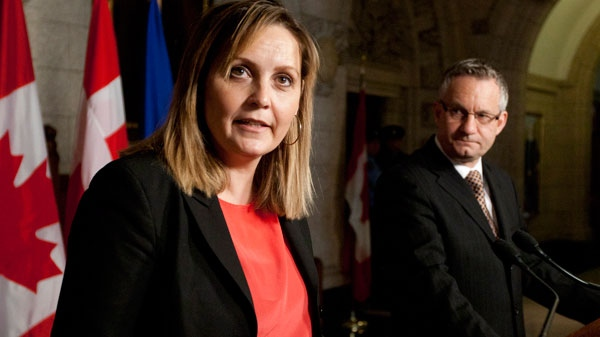 Denmark's Minister for Trade and Investment Pia Olsen Dyhr responds to a question as Canadian International Trade Minister Ed Fast looks on during a joint news conference following meetings in Ottawa, Monday April 23, 2012. (Adrian Wyld / THE CANADIAN PRESS)