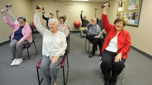 A group of seniors exercise with the help of an exercise video they are watching during a weight management and exercise class in Doylestown, Pa., Feb. 17, 2009. (The Philadelphia Inquirer / Sharon Gekoski-Kimmel)