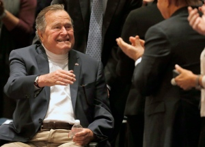 Former President George H.W. Bush acknowledges the crowd at his presidential library on Tuesday, Nov. 11, 2014, in College Station, Texas. Tuesday will mark one week since the 90-year-old Bush was taken to hospital. (AP/Texas Tribune, Bob Daemmrich, Pool)