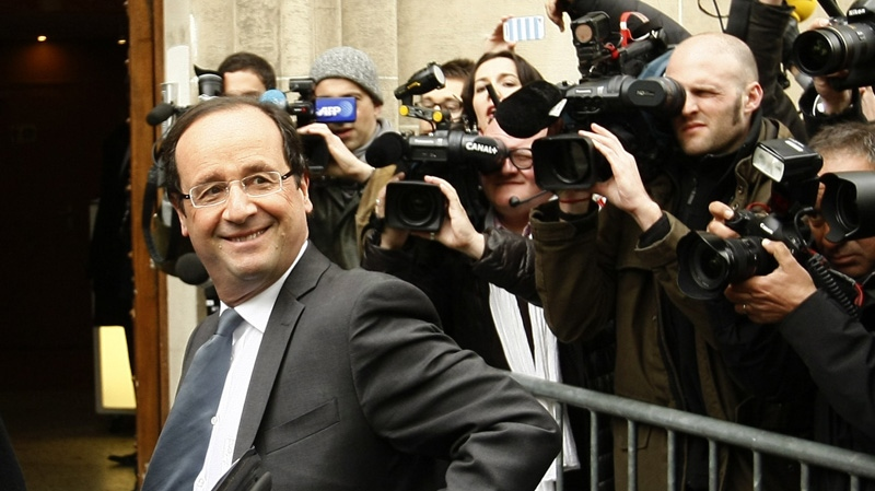 French Socialist party candidate Francois Hollande arrives at his campaign headquarters on the morning after the first round of the French presidential elections in Paris, France, Monday, April 23, 2012. (AP Photo/Michel Spingler)