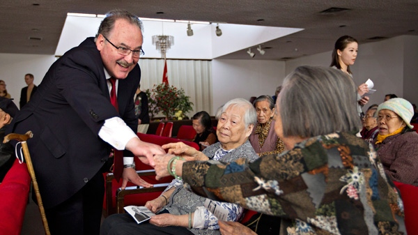 Alberta NDP leader Brian Mason meets with residents at the Chinese Elders Mansion during a campaign stop in Edmonton Alta. Sunday April 22, 2012. (Jason Franson / THE CANADIAN PRESS)