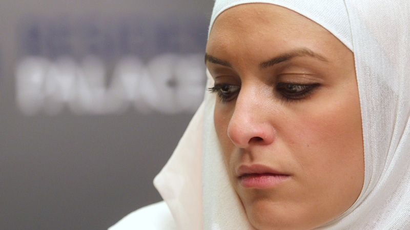 Belgium's Hejare Boujtat gives here testimony during a media conference, at the presentation of a report by Amnesty International called 'Choice and prejudice: discrimination against Muslims in Europe' in Brussels, Tuesday, April 24, 2012. (AP Photo/Yves Logghe)