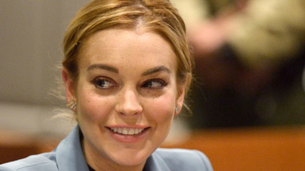 Lindsay Lohan smiles in court during a progress report on her probation for theft charges at Los Angeles Superior Court, Thursday, March 29, 2012. (AP / Joe Klamar)