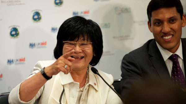 International Development Minister Bev Oda points at a donors conference in London, Eng., last year for a global health organization that works to immunize children in poor countries. (Ben Fisher / THE CANADIAN PRESS)