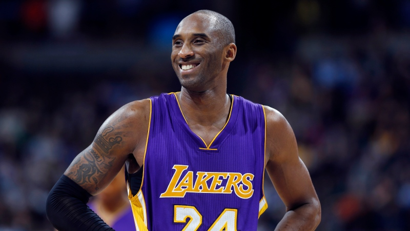 Los Angeles Lakers guard Kobe Bryant stands on the court during an NBA basketball game against the Denver Nuggets, Tuesday, Dec. 30, 2014, in Denver. Bryant makes his potentially last game trip to Florida Tuesday (AP Photo/David Zalubowski)